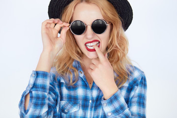 bright closeup portrait picture of funny teenage girl in shades