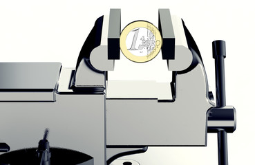 vise is holding and squeezing euro coin