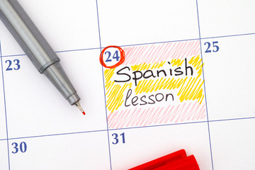 Reminder Spanish lesson in calendar with pen