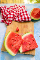 Watermelon fruit slices on rustic blue wooden table