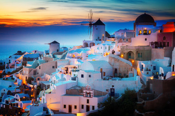 lights of Oia village at night, Santorini Greece, toned