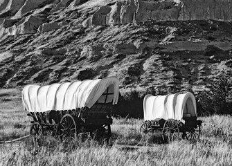 USA, Nebraska, Scotts Bluff National Monument. Covered wagons in field.    (Large format sizes available)