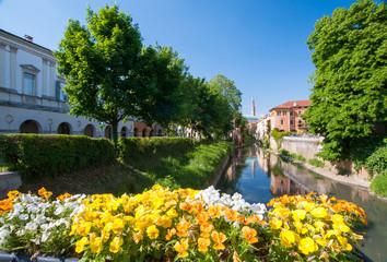 Flowered balcony of Monte Furo in Vicenza, Italy, with a view of retrone river and the clock tower in the distance