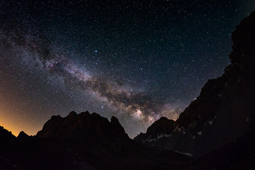 The outstanding beauty of the Milky Way arc and the starry sky captured at high altitude in summertime on the Italian Alps, Torino Province. Fisheye scenic distortion and 180 degree view.