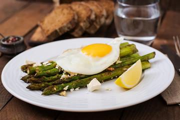 Warm salad of roasted asparagus, feta cheese and eggs