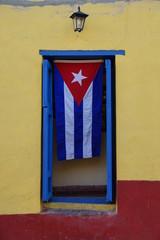 Deurstickers Havana Cuban flag hanging on a door in Trinidad