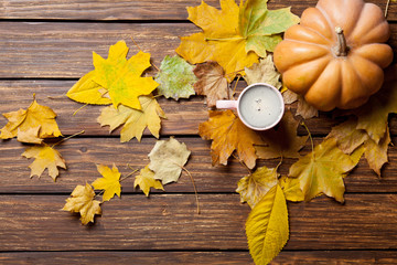 fallen leaves, pumpkin and cup of coffee