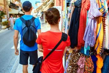 couple tourists walking in the old town. tourists considering the narrow streets of the city, stroll through the bazaar
