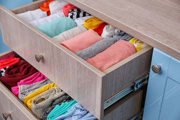 Fototapeta Neatly folded clothes in chest of drawers obraz