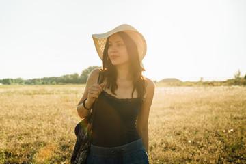 Hippie girl walking in nature, enjoying sunny day