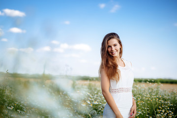 Beautiful woman in field
