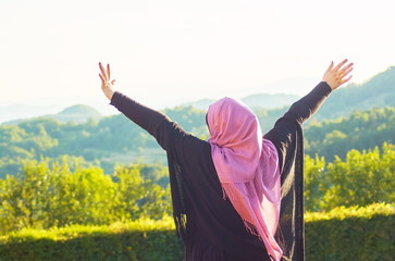 Muslim woman with veil spending good time at sunny day