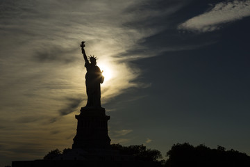USA, New York, New York City, Silhouette of Statue of Liberty at sunset