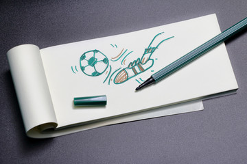 kicking football sketch on Note Paper