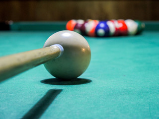 pool game ready to start with pool cue against white ball