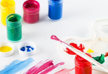 Painting brush with paint and colorful paint on white  background