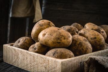 Organic potatoes on a wooden box