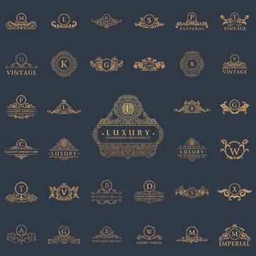 Luxury vintage logos set. Calligraphic emblems and elements