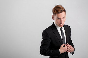 young man in a black suit