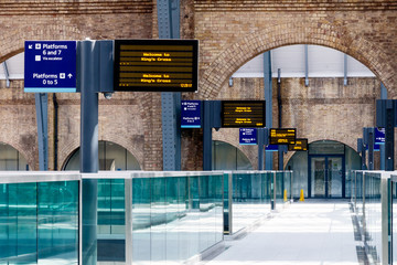 Aluminium Prints Train Station Digital timetables and platform signs at Kings Cross Station, London, UK