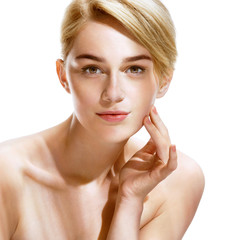 Beautiful spa woman touching her face. Close up of an attractive girl of European appearance on white background. Youth and Skin Care Concept.