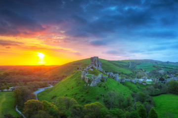 Ruins of the Corfe castle at beautiful sunrise in County Dorset, UK Wall mural