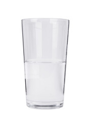 A half full pint glass of water isolated on a white background