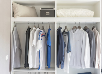 clothes hanging in white closet