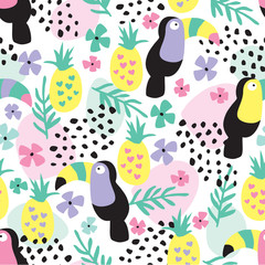 Tropical toucans and pineapples seamless pattern vector illustration