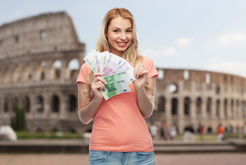 happy young woman with euro cash money