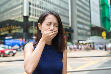 Woman feeling sick at outdoor