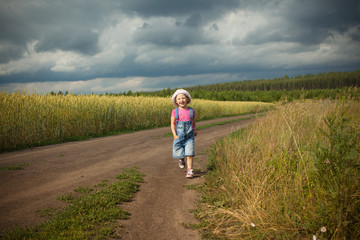 child running in a field