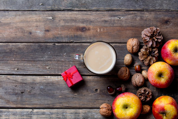 apples, fir-cones, cup of coffee, gift and nuts