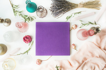 purple wedding or family photo album, roses, lavender, green eucalyptus branches, candles, candlesticks, pink dress isolated on white background. flat lay, overhead view