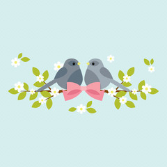 Two birds sitting on blooming branches