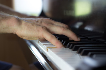 Hands Playing Piano With a Narrow Field of Focus