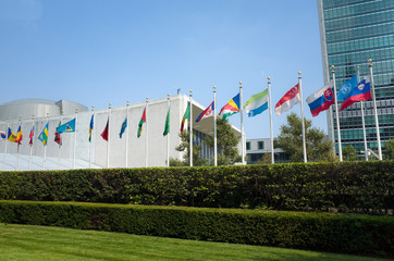 UN United Nations general assembly building with world flags fly