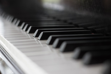 close up of a piano keyboard with a narrow field of focus