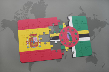 puzzle with the national flag of spain and dominica on a world map background.