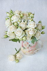 Beautiful fresh pink roses flowers in a vase .