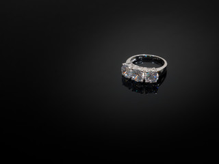Diamond Rings on black shine table.