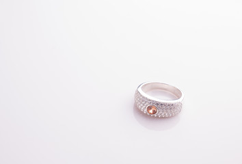 Jewel ring on white shine table