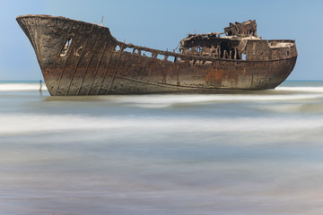 Acrylic Prints Shipwreck Rusty boat aground on the coast of Morocco