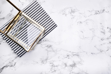 Woman desktop elegant. Flat lay. Gold items on the table. Marble mock-up background. Header or hero website. mock up for artwork .View from above