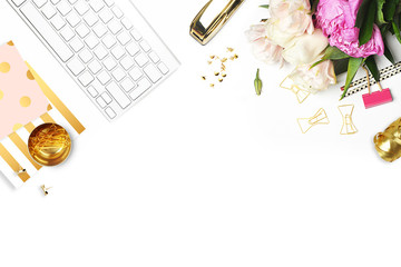 Flat lay. Flower on the table. Keyboard and stapler,  stationery supplies. Glamour style Table view. Business accessories. Mock-up background. Peonies