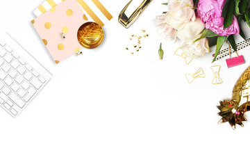 Flat lay. Flower on the table. Keyboard and stapler. Table view. Business accessories. Mock-up background. Peonies