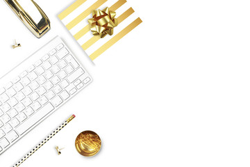 Flat lay, office white desk and keyboard with gold stationery. Gold stapler, stripe gold pattern, pencil. View top. Table up. Mock-up background