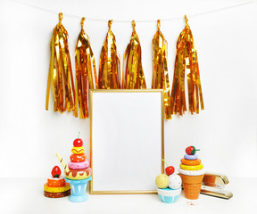 Mockup frame.Gold frame and white wall. Gold tassel and sweet bar. Ice cream, cupcakes, cherry.