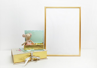 Gold frame mock-up, and white wall with toys.mouse, gold and mint book Place work