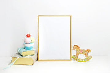 gold picture frame with decorations. Mock up for your photo or text Place your work, print art,shabby style, white background, pastel color book, gold pineapple, toy hourse